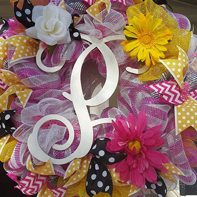 A beautiful mesh monogram door wreath by CJC Creations.